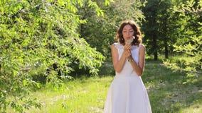 Beautiful Woman Blowing Dandelion Seeds. Full HD stock footage