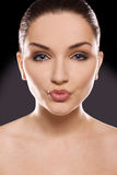 Beautiful woman blowing kiss Royalty Free Stock Photography