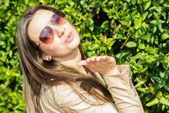 Beautiful woman blowing a kiss. Beautiful young woman blowing a kiss Royalty Free Stock Images