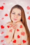 Beautiful woman blowing kisses with red palm Stock Photography