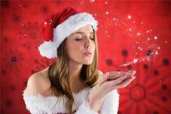 Beautiful woman blowing magic dust Stock Photography