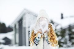 Beautiful woman blowing in the snow Stock Photo