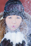 Beautiful woman blowing snow Stock Photography