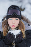 Beautiful woman blowing snow Royalty Free Stock Photos