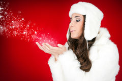 Beautiful  woman blowing snowflakes Royalty Free Stock Photography