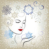 Beautiful woman blowing snowflakes - stylized Stock Photography