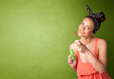 Beautiful woman blowing soap bubble on copyspace background Royalty Free Stock Images