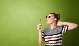 Beautiful woman blowing soap bubble on copyspace background Stock Photo