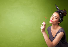 Beautiful woman blowing soap bubble on copyspace background Stock Images