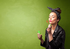 Beautiful woman blowing soap bubble on copyspace background Stock Photography
