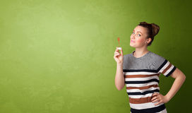 Beautiful woman blowing soap bubble on copyspace background Royalty Free Stock Photos