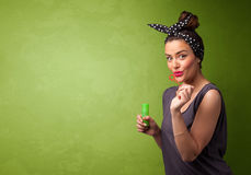 Beautiful woman blowing soap bubble on copyspace background. Beautiful woman blowing soap bubble on copyspace green background Royalty Free Stock Photos