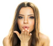 Beautiful woman blowing up kiss Stock Photography
