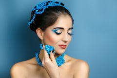 Beautiful woman with blue accessory. Portrait of beautiful young girl woman model. Bright expressive makeup blue eyes perfect skin natural lips. Nautical fresh Stock Images