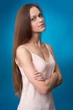 Beautiful woman on blue background Royalty Free Stock Image