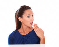Beautiful woman in blue blouse looking surprised Stock Images