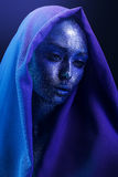 Beautiful woman with blue bodyart in scarf Royalty Free Stock Photography