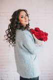 Beautiful woman in blue coat with red roses in craft paper Royalty Free Stock Images