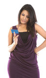 Beautiful woman with blue credit card. Beautiful woman seeing the blue credit card Royalty Free Stock Image