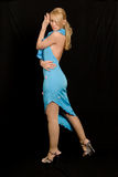 Beautiful woman in blue dress. Beautiful woman in blue dress on black background Stock Photos