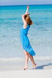 Beautiful woman in blue dress on beach in summer Stock Photos