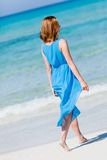 Beautiful woman in blue dress on beach in summer Royalty Free Stock Photography