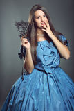 Beautiful woman with blue dress and black mask Stock Photography