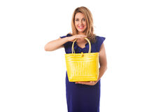 Beautiful woman in blue dress with bright yellow  tote bag.Isolated. Stock Photos
