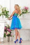 Beautiful woman in blue  dress in luxury interior. Royalty Free Stock Photography