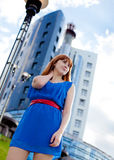 Beautiful woman in blue dress outdoors Stock Photography