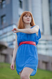 Beautiful woman in blue dress outdoors Royalty Free Stock Photo