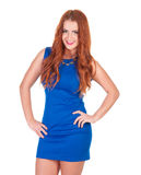 Beautiful woman in blue dress posing. Over white background Royalty Free Stock Image