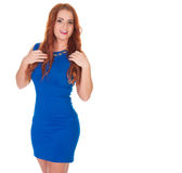 Beautiful woman in blue dress posing. Over white background Royalty Free Stock Photography