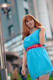 Beautiful woman in blue dress and red belt Stock Photo