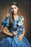 Beautiful woman with blue dress and venetian mask Stock Image