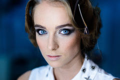 Beautiful woman with blue eyes and makeup Stock Photography