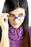 Beautiful woman with blue glasses looking Royalty Free Stock Image