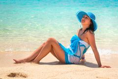 Woman in blue hat on the tropical beach Royalty Free Stock Photography