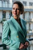 Beautiful woman in blue jacket at balcony stock image