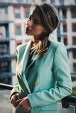 Beautiful woman in blue jacket at balcony stock images