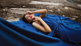 Beautiful woman in blue long dress. Outdor. Nature. Royalty Free Stock Images