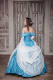 Beautiful woman in blue medieval dress stock photography