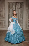 Beautiful woman in blue medieval dress Stock Photo