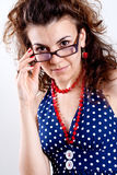 Beautiful woman in a blue polka dot dress Royalty Free Stock Images