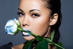 Beautiful woman with blue rose Stock Photo