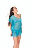 Beautiful woman in blue dress looking upward Stock Photo