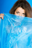 Beautiful woman with blue silk Royalty Free Stock Image