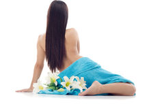 Beautiful woman with blue spa towels on white Stock Photos