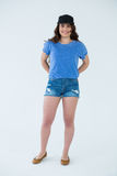 Beautiful woman in blue top and cap Stock Photos