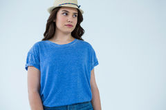 Beautiful woman in blue top and hat Stock Images